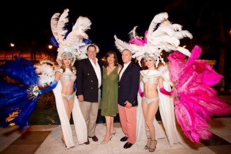 Mason Phelps, Julie Pickens and Ron Neal flanked by showgirls. (Photo: by LILA)