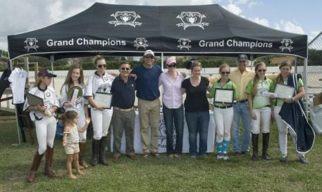 All smiles from left to right, Mia Astrada and her little sister; Riley Ganzi, Chase Schwartz, USPA CEO Peter Rizzo, Grand Champions coach John Gobin, I/I Director Amy Wisehart, I/I Program Assistant Ali Davidge, Rachel Kelly, The Polo School coach Charlie Muldoon, Alyssa Tranchilla, Jacqui Casey. Photo by Scott Fisher