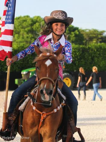 Alexandra Sky Ortiz and Angus brought in the American flag for the national anthem
