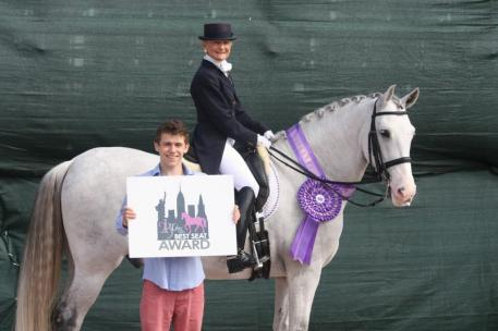 Janne Rumbough and Junior are presented with the 2kGrey Best Seat Award by Austen Stone