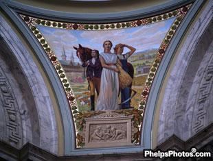 An image of a horse held by a rider is part of the artwork in the rotunda of the Kentucky State Capitol building.