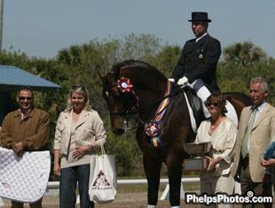 "Charlotte Bernal with Marco and Farewell IV winning the Marty Simensen Memorial Trophy at the 2010 Palm Beach Dressage Derby. Pictured to the right is Holly Simensen and international ""O"" judge Stephen Clarke"