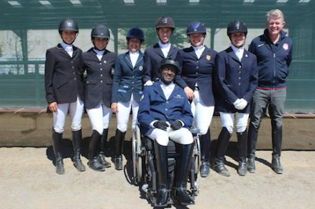 USA Riders at the Golden State Dressage Classic CPEDI3* (Left to Right) Elizabeth Traband, Holly Bergay, Deborah Stanitski, Kate Shoemaker, Susan Treabess, Ashleigh Flores-Simmons, Chef d'Equipe Kai Handt, and up front is U.S. Air Force Veteran Derrick Perkins. Photo by John Stevenson.