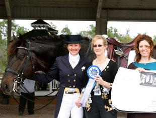 Tina Konyot (left) and her horse Calecto V won the Grand Prix Open class at the Gold Coast Dressage Association Opener. Draper Equine Therapy sponsored Konyot's class and Show Manager Noreen O'Sullivan (center) and Draper Product Manager Kat Wojtylak presented Konyot with a Draper saddle pad.
