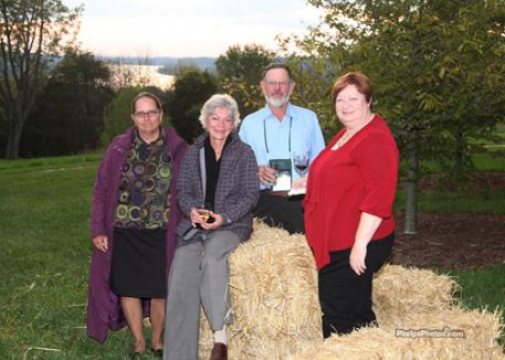 Event officials Dana Bright, Sue Mott, Leonard Courtemanche and Jill Ryder enjoy the sunset on the Ohio at the competitor's party at Steve Wilson and Laura Lee Brown's Woodland Farm