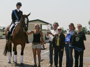 Arlene Page and Alina collect the Champions Cup from IHS partners Ed Borreson, Melissa Taylor (for Lars Petersen) amd Noreed O'Sullivan with judge Cara Whitham.