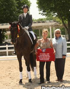 dressagedaily's Mary Phelps Hathaway Markel Equine Insurance Specialist for the central US Dressage region joins judge Linda Zang in awarding the reservechampions cooler to Allure in 2011