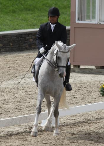 Win competes as a Grade IV rider, the least impaired classification.