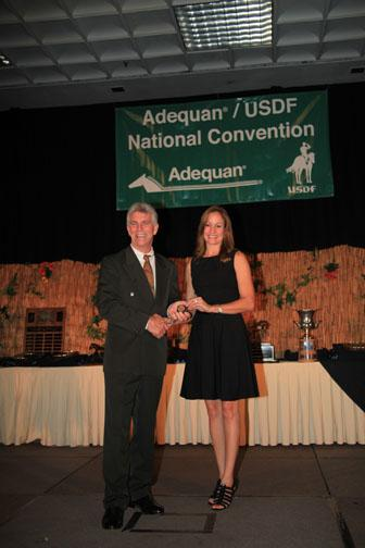 USDF president George Williams presents Debbie Hill with her USDF Gold Medal at the 2011 Adequan/USDF Salute Gala and Annual Awards Banquet. (photo: phelpsphotos.com)