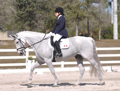 Jody Schloss and Inspector Rebus 2012 won the Overall Best Presentation at the Houston Dressage Society CPEDI3* FEI JOG
