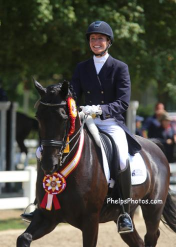 Charlotte and her 8-year-old black Dutch Warmblood gelding Adventure, by Ferro son Special D, won the 2013 Markel/USEF National Developing Horse Prix St. Georges Reserve Championship Photo: Mary Phelps