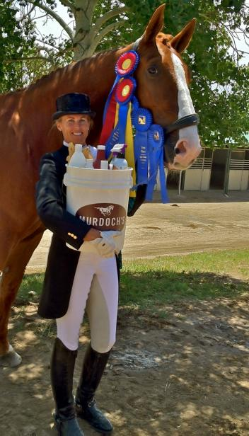 Suzie Halle and Tennyson ISF, by Contango, earned two FEI Amateur/Junior High Points and one Reserve High Point during June High Prairie Dressage at the Colorado Horse Park. Among their awards were beautiful gift buckets full of prizes from Murdoch's Ranch and Home Supply.