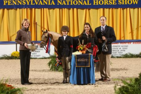 ARMANI and Madeline Schaefer receive the Grand Champion Pony Hunter Award from PNHS President Liz Shorb