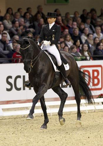 A lovely debut of Dorothee Schneider and her 9 year old Diva Royal for place three Picture Julia Rau, www.rauphoto.de