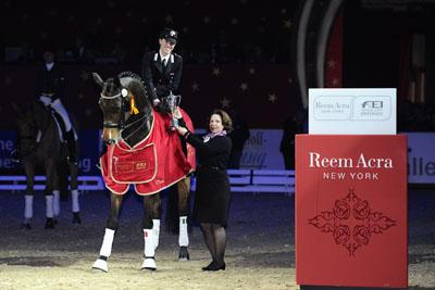 Italy's Valentina Truppa pictured with Lisa Wells from Reem Acra after her victory, riding Eremo Del Castegno, in the fifth leg of the Reem Acra FEI World Cup™ Dressage 2011/2012 series at Frankfurt, Germany Photo: FEI/Karl-Heinz Frieler