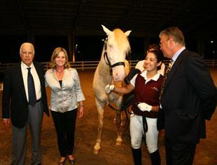 From left to right, Dr Paulo Gonzaga, Nancy Kempe, Monique da Silva, and Peter van Borst. Kempe, a dressage rider from Houston, Texas, was the highest bidder of the evening during the 2011 Lusitano Collection International Horse Auction, buying the beautiful Lusitano Isabel stallion Cupido Interagro. (Photo courtesy of Darcy Scott)