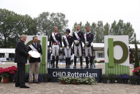 Great Britain won the second leg of the FEI Nations Cup™ Dressage 2013 series at Rotterdam, The Netherlands today. Pictured on the podium (L to R): Carl Hester, Charlotte Dujardin, Daniel Watson and Gareth Hughes. (Photo: FEI/Dirk Caremans)