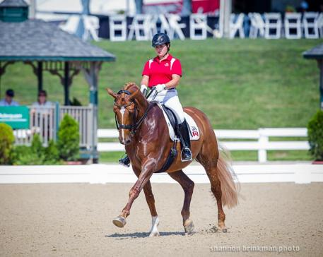 Tanya Shostak Strasser and Action Tyme in their FEI Young Rider Team Championship performance. (Photo: Anthony Trollope for Shannon Brinkman photo)