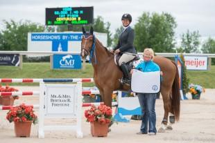 Lisa Goldman and Centurion B receive their awards from Alex Rheinheimer