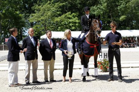 Rebecca Hart receiving 2012 USEF Para-Equestrian Dressage National Championship award from Ann Romney during the 2012 USEF Dressage Festival of Champions. Photograph taken in Gladstone, NJ  (c) Susan Stickle at SusanStickle.com.