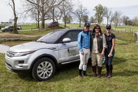 Phillip Dutton (left) and wife Evie (right) accepted a 2014 Range Rover Evoque from Kim McCullough, the Land Rover of North America vice president for branding, at the Rolex Kentucky Three-Day Event, presented by Land Rover. (Ben Radvani photo)