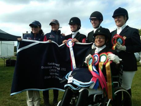 The Gold United States Para-Equestrian Team (Pictured Left to Right: Pam Lane, Chef d'equipe Missy Ransehousen, Rebecca Hart, Erin Alberda, Mary Jordan, and in front is Donna Ponessa).Photo: Hope Hand/USPEA.