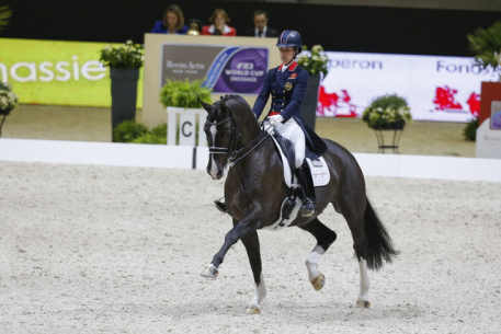 Great Britain's Charlotte Dujardin and the brilliant gelding Valegro set yet another new world record when scoring 87.129 to win today's Grand Prix at the Reem Acra FEI World Cup™ Dressage 2013/2014 Final in Lyon, France. (Photo: FEI/Dirk Caremans)