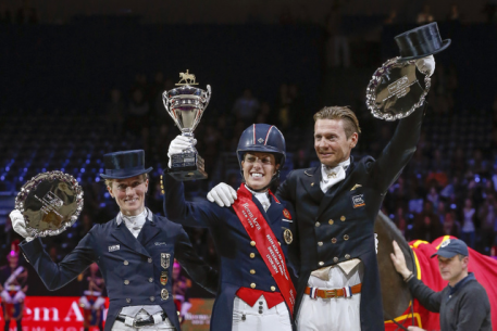 Great Britain's Charlotte Dujardin (center) claimed the Reem Acra FEI World Cup™ Dressage 2014 title today after a spectacular Freestyle performance with Valegro. Pictured with her on the prize-winner's podium are (left) runner-up Germany's Helen Langehanenberg and (right) third-place Edward Gal from The Netherlands. (Photo: FEI/Dirk Caremans)
