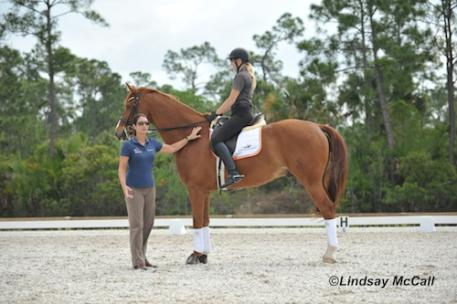 Catherine Haddad Staller with Hotmail speaking to the Para-Equestrians about proper saddle placement and correct body position. Photo was taken at Catherine's facility in Florida. Photo by Lindsay Y McCall