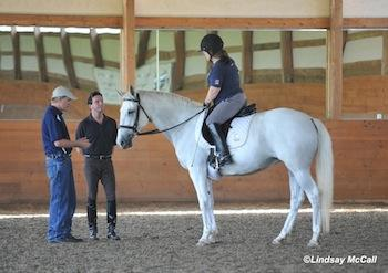 Kai Handt (Left) works with Ellie Brimmer and Captiva. Gil Merrick (right). Photo (c) Lindsay McCall