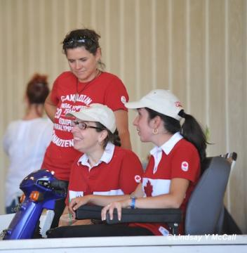 Jody Schloss (CAN) left and Robyn Andrews (CAN) right relaxing after the FEI Jog