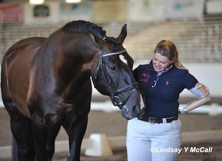 Susan Treabess of Winters, Calif. and horse Kamiakin smile together as they prepare for the FEI Para-Equestrian Dressage Jog for the CPEDI3* at Golden State Dressage