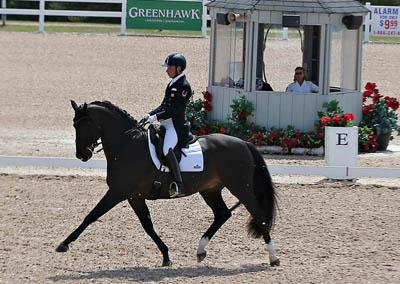 Canadian Olympian David Marcus of Campbellville, ON, and his 2012 Olympic mount, Chrevi's Capital, won the Grand Prix class at CDI-W Cornerstone Spring Into Dressage. Photo Credit: Michael Werner Images
