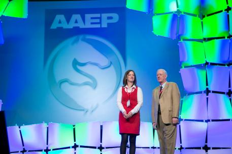 Markel Underwriter Dianne Weidner with AAEP Foundation Chairman Wayne McIlwraith celebrating 25 years of the scholarship program at the  Student Luncheon at the AAEP's 59th Annual Convention in Nashville, Tenn.
