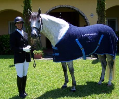 Trainer Carmen Franco and Nan Sexton's Lusitano stallion, Acolito Interagro, won the High Score Lusitano Award at the Wellington Classic Dressage in the Tropics sponsored by Interagro Lusitano's hosts of the 2012 auction later this month Photo: Carmen Franco