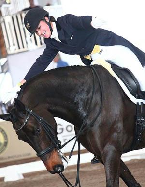 Adrienne Lyle and Wizard celebrate victory in the World Dressage Masters Grand Prix Special