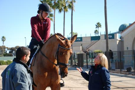 Adrienne Lyle, coach Debbie McDonald and Accolade, a half sister to Brentina. (Photo: Kelly Sanchez)