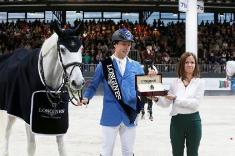 Elisa Gasparini, Brand Manager Longines Italy, presents Christian Ahlmann with his winner's watch after the German rider won the thrilling third leg of the Longines FEI World Cup™ Jumping Western European League 2013/2014 at Verona, Italy today riding Aragon Z.  Photo: FEI/Stefano Secchi.