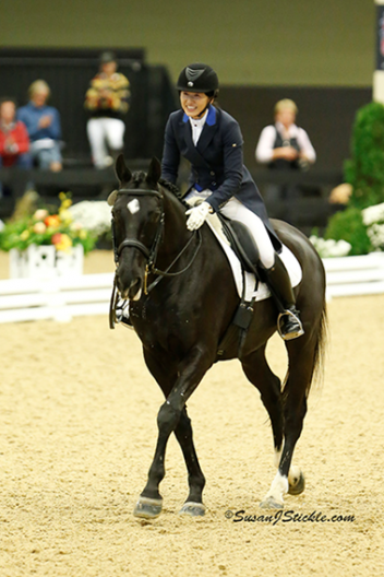 "California's Akiko Yamazaki celebrated her success aboard ""Matrix"" in the Prix St. Georges Adult Amateur Championship on the final day of the US Dressage Finals presented by Adequan®.  Photo: SusanJStickle.com"