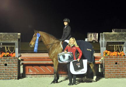 Alexa Bayko and Modigliani are presented with winner's honors, including a Horze Equestrian cooler, by Emily Smith of Platinum Performance after winning the ,000 Platinum Performance Hunter Prix at HITS Ocala. ©ESI Photography