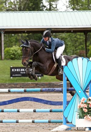 Alissa Kinsey and Grisset jump to a win in the ,000 M&S Child/Adult Jumper Classic.©ESI Photography