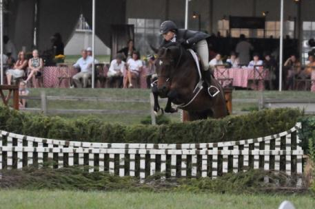 Alliy Moyer and Carlson win the 5,000 National Hunter Derby.