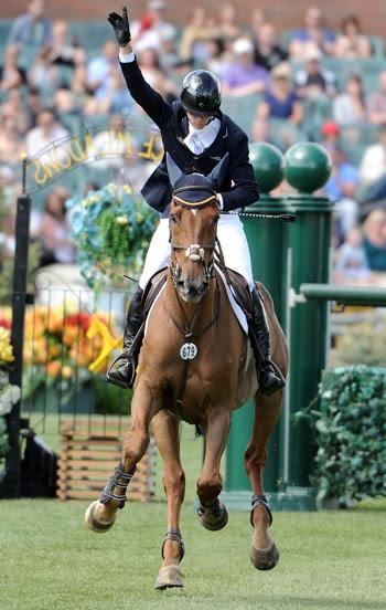 Angel Karolyi celebrates a clear jump-off performance with Hollow Creek Farm's Indiana 127 in the 0,000 CNOOC Nexen Cup Derby at Spruce Meadows. Photo by Spruce Meadows Media Services