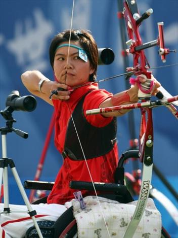 Archer competes in 2008 Beijing Paralympics
