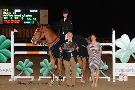 Winner's awards, including a Horze Equestrian cooler, are presented to Ashlee Bond Clarke and Chela LS after they won the ,500 HITS Desert Classic, presented by Zoetis, at HITS Thermal. ©Flying Horse Photography
