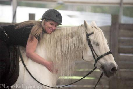 Ashley Waller in love with a new and handsome movie star, her stallion Listo. Photo: LynneRafPhotography.com