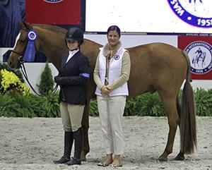 Ashton Alexander & Storyteller owned by Samantha Kasowitz presented by Bridget Love Meehan, WIHS Executive Director. Photo courtesy of WIHS.