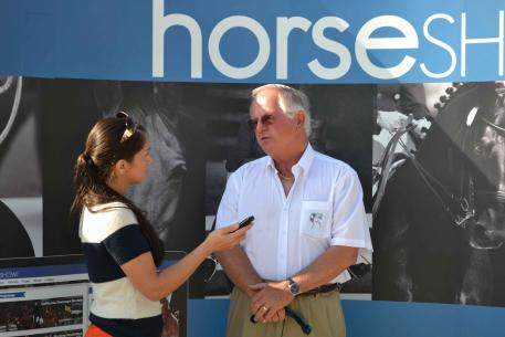Anne Margaret Meyers of HorseShow.com interviews guest judge Axel Steiner during the 45th Anniversary California Dressage Society Championships Presented By HorseShow.com. (Photo: Jennifer M. Keeler)