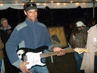 Carl Chandler got a guitar signed by Bruce Springsteen in 2010
