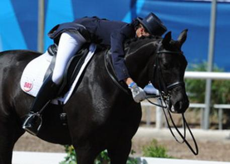 Venezuelan Beatriz Torbay Acevedo was psyched when she finished her ride on Don Royal and gave him the biggest hug with a supporting smile.(photo: Diana de Rosa)